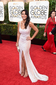 Emmanuelle Chriqui was a head turner at the Golden Globes in a figure-hugging beaded gown with a thigh-high slit.