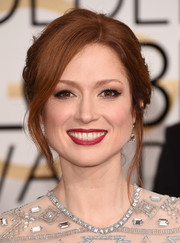 Ellie Kemper attended the Golden Globes wearing a romantic loose bun with bangs hanging down in a subtle wave.