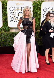 Tiziana Rocca hit the Golden Globes red carpet wearing a frothy black and pink fishtail dress.