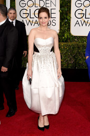 Tina Fey went the ultra-ladylike route at the Golden Globes in a custom white Antonio Berardi strapless dress featuring a bell-shaped skirt, a beaded midsection, and black waist panels.