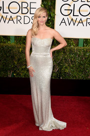 Reese Witherspoon glimmered on the Golden Globes red carpet in a sophisticated silver strapless gown by Calvin Klein.