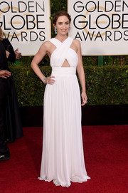 Emily Blunt was a Greek goddess with a trendy twist in a white Michael Kors gown featuring a crisscross bodice and a midriff cutout during the Golden Globes.