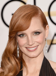 Jessica Chastain paired gorgeous diamond earrings by Piaget with a glamorous side sweep for her Golden Globes look.