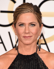 Jennifer Aniston accentuated her lips with pink gloss.
