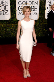 For her Golden Globes look, Felicity Huffman opted for a little white dress with bedazzled nude panels down both sides.