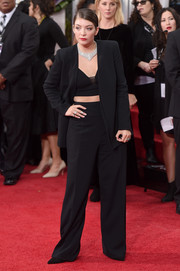 Lorde was androgynous yet sexy in a black Narciso Rodriguez pantsuit and crop-top combo at the Golden Globes.