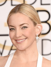 Kate Hudson styled her hair into a conservative center-parted bun for the Golden Globes.