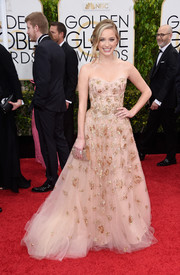 Greer Grammer absolutely enchanted at the Golden Globes in a blush-colored Lorena Sarbu strapless gown featuring gold beading and a princess-worthy tulle skirt.