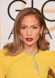 Jennifer Lopez styled her hair with a side part and feathery waves.