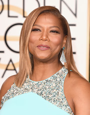 Queen Latifah showed off a super-sleek side-parted 'do at the Golden Globes.