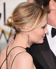 Kirsten Dunst went for an edgy look with this messy twisted bun at the Golden Globes.