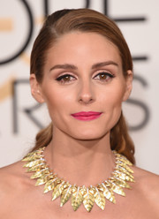 Olivia Palermo looked pretty wearing this wavy ponytail at the Golden Globes.