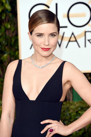 'Chicago PD' star Sophia Bush finished off her elegant black dress and sleek ponytail with classic red lipstick.