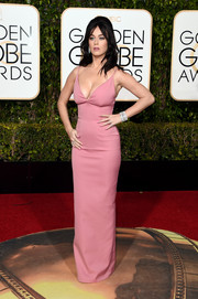 Katy Perry put on a busty display in this pink Prada column dress during the Golden Globes.