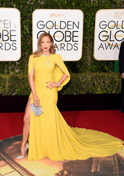 Jennifer Lopez made quite an entrance in a caped yellow fishtail gown by Giambattista Valli at the Golden Globes.