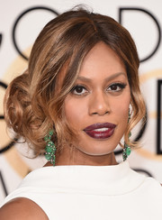 Laverne Cox attended the Golden Globes wearing her hair in glamorous pinned-up ringlets.