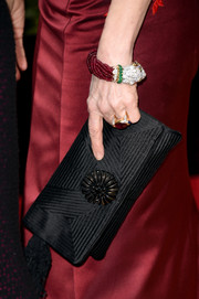Bernadette Peters carried a black woven clutch with embroidered detailing as her accessory at the 2016 Golden Globes Awards.