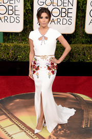 Eva Longoria cut a pretty picture in a floral-beaded gown by Georges Hobeika at the Golden Globes.