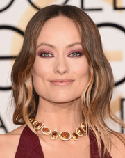 Olivia Wilde had one of the most dramatic makeup looks of the 2016 Golden Globes with her dark purple metallic eyeshadow.