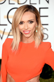 Giuliana Rancic matched her bright lipstick to her dramatic cut-out gown at the 2016 Golden Globes.