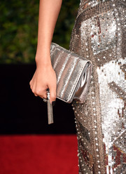 Jane Wu sparkled with her silver metallic clutch to match her sequined gown at the 2016 Golden Globes Awards.