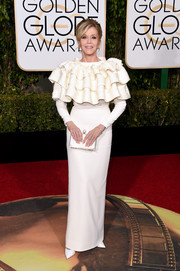 Jane Fonda got all dolled up in a white ruffle gown by Yves Saint Laurent Couture for the Golden Globes.