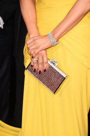 Lopez chose dark garnet nail polish to accentuate her yellow gown at the Golden Globes.