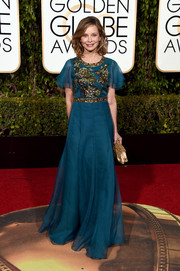 Calista Flockhart cut a regal figure at the Golden Globes in a teal Andrew Gn gown with an embroidered bodice.