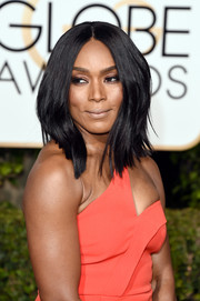 Angela Bassett framed her face with a high-volume layered 'do.