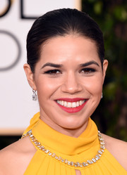 America Ferrera slicked her hair back into a tight bun for the Golden Globes.