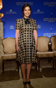 America Ferrera attended the Golden Globe nominations announcement looking oh-so-sweet in a gold and black Ingie Paris floral-sequined dress with a bowed neckline.