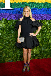 Kristin Chenoweth rounded out her ensemble with a personalized crystal clutch.