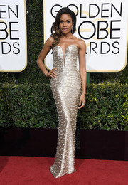 Naomie Harris looked downright divine at the Golden Globes in a strapless metallic column dress by Armani Privé.