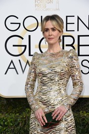Sarah Paulson arrived for the Golden Globes carrying a faceted crocodile clutch by Roger Vivier.