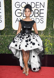 Janelle Monae looked playfully glam in a black-and-white polka-dot fishtail gown by Armani Prive at the Golden Globes.