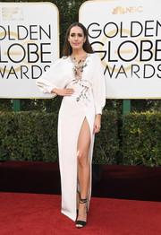 Louise Roe made an ultra-sophisticated choice with this plunging, high-slit white gown with floral beading running down the bodice for her Golden Globes look.
