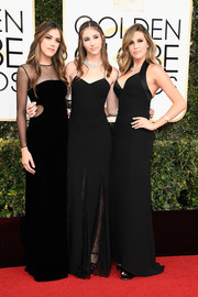 Scarlet Stallone stayed classic in a black slip dress with lace inserts on the skirt for her Golden Globes look.