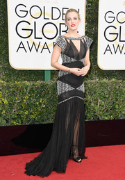 Riley Keough went for an Art Deco-inspired look with this black-and-white mermaid-hem cutout gown by Chanel Couture at the Golden Globes.