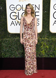 Laura Dern flaunted her ageless figure in a form-fitting floral-embroidered gown by Burberry at the Golden Globes.