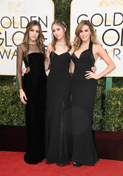 Sistine Stallone chose a sleek black velvet gown with waist cutouts and a sheer yoke and sleeves for her Golden Globes look.