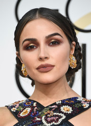Olivia Culpo tied her look together with a pair of massive gold earrings.