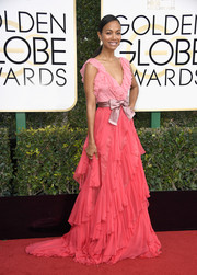 Zoe Saldana went flirty in a heavily ruffled Gucci gown in two shades of pink for her Golden Globes red carpet look.