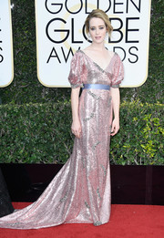 Claire Foy dazzled in a pink Erdem sequin gown with puffed sleeves and a blue waistband at the Golden Globes.