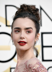Lily Collins finished off her beauty look with a matte red lip.