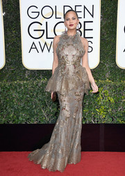 Chrissy Teigen amped up the frill factor with this metallic halter peplum gown by Marchesa at the Golden Globes.