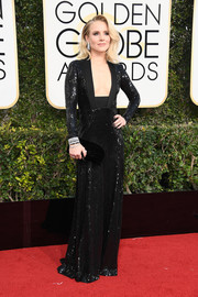 Kristen Bell sealed off her look with a black velvet clutch by Jimmy Choo.