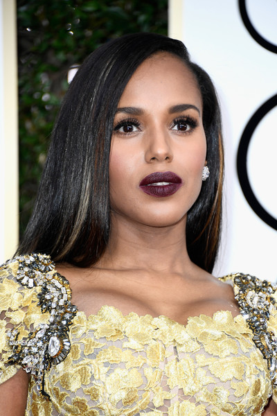 Kerry Washington coated her pout a dark berry hue.