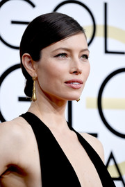 Jessica Biel styled her tresses into a sleek side-parted chignon for the Golden Globes.
