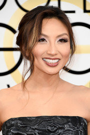 Jeannie Mai worked an elegant loose ponytail at the Golden Globes.