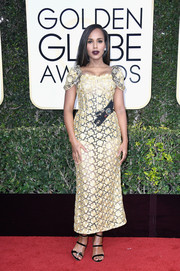 Kerry Washington went for subtle sexiness in a semi-sheer yellow corset dress by Dolce & Gabbana at the Golden Globes.